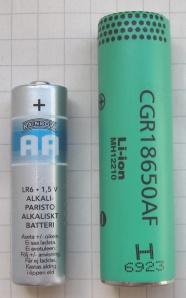 A standard AA battery next to an 18650